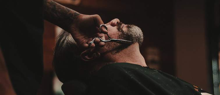 Barber shaving man
