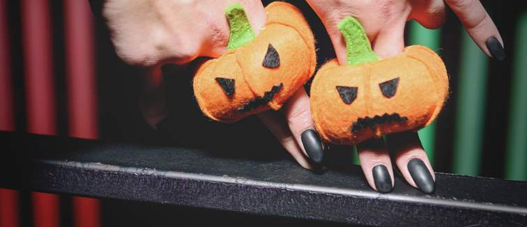 black manicure and pumpkin puppets